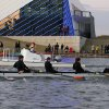 Members of the Putnam City High School crew row past the Devon Boat House during the OKC Riversport Youth League Championship on the Oklahoma River in downtown Oklahoma City, Wednesday, November 16, 2011. PHOTO BY HUGH SCOTT, FOR THE OKLAHOMAN ORG XMIT: KOD