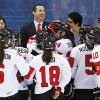 Canada head coach Kevin Dineen celebrates with players after Canada beat Switzerland 3-1 in a 2014 Winter Olympics women\'s semifinal ice hockey game at Shayba Arena, Monday, Feb. 17, 2014, in Sochi, Russia. (AP Photo/Julio Cortez)