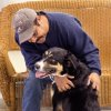 Lupe Sandoval becomes acquainted with new male Bernese Mountain Dog mix that he and his wife, Lori, adopted Wednesday, Dec. 14, 2011, at the animal shelter. Sandoval and his wife said the dog is a good farm dog and he will fit in wonderfully with their horses and cattle on the 40 acres of land where they live in El Reno. Lupe thinks his new dog is large enough to help