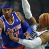 The basketball moves in front of Boston Celtics forward Jared Sullinger (7) on New York Knicks forward Carmelo Anthony\'s pass during the second quarter of an NBA basketball game in Boston, Thursday, Jan. 24, 2013. (AP Photo/Charles Krupa)