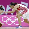 Australia\'s Jennifer Screen, left, and Russia\'s Becky Hammon, right, chase a loose ball during a preliminary women\'s basketball game at the 2012 Summer Olympics, Friday, Aug. 3, 2012, in London. (AP Photo/Eric Gay)