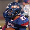 Moore\'s Ryan Lujan (21) runs as th Lions play the Lawton Eisenhower Eagles in a high school football game on Friday, Oct. 5, 2012, in Moore, Okla. Photo by Steve Sisney, The Oklahoman
