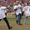Photo - Former Cincinnati Reds pitchers, from left , Rob Dibble, Randy Myers, and Norm Charlton throw out ceremonial first pitches prior to a baseball game against the Chicago Cubs, Monday, July 7, 2014, in Cincinnati. The three were known as the