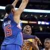 Los Angeles Lakers guard Kobe Bryant (24) looses the ball as he battles Los Angeles Clippers center Ryan Hollins (15) in the first half of an NBA basketball game, Friday, Nov. 2, 2012, in Los Angeles.(AP Photo/Gus Ruelas)