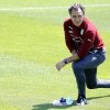 Photo - Italy coach Cesare Prandelli  looks at a training session in Coverciano training complex, in Florence, Italy, Tuesday, May 20 , 2014,   Italy opened its World Cup training camp Monday with 31 players.  Prandelli needs to trim his squad to 23 players by June 2.  In Brazil, Italy is in Group D with England, Uruguay and Costa Rica. (AP Photo/Fabrizio Giovannozzi)