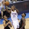 Oklahoma City\'s Kevin Durant (35) goes between Miami\'s Shane Battier (31), and Miami\'s LeBron James (6) during Game 2 of the NBA Finals between the Oklahoma City Thunder and the Miami Heat at Chesapeake Energy Arena in Oklahoma City, Thursday, June 14, 2012. Photo by Chris Landsberger, The Oklahoman