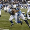 Photo - Indianapolis Colts running back Donald Brown (31) scores a touchdown on a 6-yard run as Tennessee Titans safety Michael Griffin (33) tries to bring him down in the third quarter of an NFL football game Thursday, Nov. 14, 2013, in Nashville, Tenn. (AP Photo/Mark Zaleski)