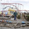 Photo -   The Fun Town Pier in Seaside Heights has been heavily damaged. Owner Billy Major surveys the damage Wednesday, Oct. 31, 2012. Only four of the rides on the pier survived superstorm Sandy. (AP Photo/Star-Ledger, David Gard/POOL)