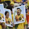 Photo - Brazil soccer fans place their faces in a cut-out posters before the World Cup round of 16 soccer match between Brazil and Chile at Mineirao Stadium in Belo Horizonte, Brazil, Saturday, June 28, 2014. (AP Photo/Martin Meissner)