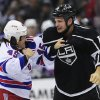 Photo - New York Rangers right wing Arron Asham (45) and Los Angeles Kings left wing Kyle Clifford (13) fight during the second period of an NHL hockey game, Monday, Oct. 7, 2013, in Los Angeles. (AP Photo/Gus Ruelas)