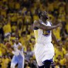 Photo - Golden State Warriors forward Draymond Green reacts after scoring against the Denver Nuggets during the first half of Game 4 in a first-round NBA basketball playoff series, Sunday, April 28, 2013, in Oakland, Calif. (AP Photo/Ben Margot)