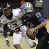 Guthrie\'s Bryan Dutton (16) dodges East Central\'s Kimmee Carson (7) during a high school football game between Guthrie and East Central at The Rock in Guthrie, Friday, Nov. 18, 2011. Photo by Garett Fisbeck, The Oklahoman