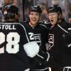 Photo - Los Angeles Kings center Tyler Toffoli, right, celebrates his power-play goal with teammates Jarret Stoll , left, who recorded an assist, and Tanner Pearson, center, against the Anaheim Ducks during the second period of an NHL hockey game in Los Angeles, Saturday, March 15, 2014. (AP Photo/Danny Moloshok)