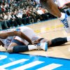 Photo - Oklahoma City's Kevin Durant is slow to get up after a collison in the first half of their game against Houston during their NBA basketball game at the OKC Arena in downtown Oklahoma City on Wednesday, Nov. 17, 2010. Photo by John Clanton, The Oklahoman