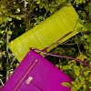 Cole Haan purple cross body bag, Brahmin embossed neon clutch and Tres Vero mint satchel, available at Dillard\'s, Penn Square Mall. CHRIS LANDSBERGER