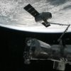 This image from NASA-TV shows the capture of the Dragon capsule by a robot arm on the International Space Station as they passed over the South Atlantic Ocean early Wednesday Oct. 10, 2012. It\'s the first official delivery by the California-based SpaceX company under a $1.6 billion contract with NASA. The contract calls for 12 such shipments. (AP Photo/NASA)
