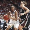 OU's Nyeshia Stevenson, left, drives past Kim Sitzmann of Arkansas-Little Rock in the first half of Tuesday's game in Norman. Photo by Steve Sisney, The Oklahoman