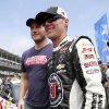 Photo - Actor Chris Pratt, left, stands with Kevin Harvick before the Brickyard 400 auto race at Indianapolis Motor Speedway in Indianapolis, Sunday, July 27, 2014. (AP Photo/R Brent Smith)