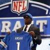 Photo - Ezekiel Ansah, from Brigham Young, holds up a team jersey after being selected fifth overall by the Detroit Lions in the first round of the NFL football draft, Thursday, April 25, 2013, at Radio City Music Hall in New York. (AP Photo/Jason DeCrow)