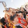 The Dewar softball team celebrates its Class 3A title on Tuesday. Photo by Nate Billings, The Oklahoman
