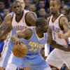 Oklahoma City\'s Nazr Mohammed (8) and Oklahoma City\'s Eric Maynor (6) defend on Denver\'s Raymond Felton (20) during the first round NBA playoff game between the Oklahoma City Thunder and the Denver Nuggets on Sunday, April 17, 2011, in Oklahoma City, Okla. Photo by Chris Landsberger, The Oklahoman