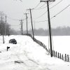 A truck makes it way through a snow-covered road in Beaver, W.Va., Wednesday, Oct. 31, 2012. Superstorm Sandy has already dumped up to 2 feet of snow in West Virginia, cutting electricity to about 271,00 customers and closing dozens of roads. (AP Photo/The Register-Herald, Rick Barbero) ORG XMIT: WVBEC102