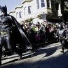 """Miles Scott, dressed as Batkid, right, runs with Batman after saving a damsel in distress in San Francisco, Friday, Nov. 15, 2013. San Francisco turned into Gotham City on Friday, as city officials helped fulfill Scott\'s wish to be """"Batkid.""""Â Scott, a leukemia patient from Tulelake in far Northern California, was called into service on Friday morning by San Francisco Police Chief Greg Suhr to help fight crime, The Greater Bay Area Make-A-Wish Foundation says. (AP Photo/Jeff Chiu)"""