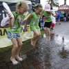Photo - Kalie Mithcell, left, 11, and her sisters Lacie, 5 and Alexis, 9, right, play in a puddle in the Fan Zone after a rain shower before the NASCAR Sprint cup Series auto race at Daytona International Speedway in Daytona Beach, Fla., Saturday, July 5, 2014. (AP Photo/Terry Renna)