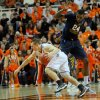 Oklahoma State guard Phil Forte dribbles around West Virginia defender Aaric Murray during an NCAA college basketball game in Stillwater, Okla., Saturday, Jan. 26, 2013. (AP Photo/Tulsa World, KT King) ONLINE OUT; TV OUT; TULSA OUT