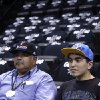 Spurs Fan Johnny Rodriquez and his son Thunder fan John Paul watch the Thunder warm up before Game 1 of the Western Conference Finals in the NBA playoffs between the Oklahoma City Thunder and the San Antonio Spurs at the AT&T Center in San Antonio, Monday, May 19, 2014. Photo by Sarah Phipps, The Oklahoman