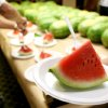 Megan Hitt, of Rush Springs, serves watermelons to visitors and employees at the state Capitol in Oklahoma City on Wednesday, July 29, 2009. By John Clanton, The Oklahoman