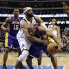 Dallas Mavericks\' Vince Carter, center, fouls Los Angeles Lakers\' Kobe Bryant as the two chase down a loose ball late in the second half of an NBA basketball game, Sunday, Feb. 24, 2013, in Dallas. The Lakers won 103-99. (AP Photo/Tony Gutierrez)