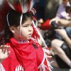 Kyle Harden of the Lakota Creek tribes walks in the Red Earth parade on Friday, June 7, 2013. Kyle was also competing in the fancy dance category of the annual dance contest later that night. Photo by Aliki Dyer, The Oklahoman