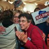 Cathy Razner, left, Angie Kirst, center, and Peggy Scherman all react President Barack Obama re-election at a party Tuesday, Nov. 6, 2012, in Madison, Wis. (AP Photo/Andy Manis)