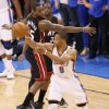 Oklahoma City\'s Russell Westbrook (0) passes the ball past Miami\'s Mario Chalmers (15) during Game 2 of the NBA Finals between the Oklahoma City Thunder and the Miami Heat at Chesapeake Energy Arena in Oklahoma City, Thursday, June 14, 2012. Photo by Nate Billings, The Oklahoman