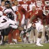 OU\'S DeMarco Murray runs past Darcel McBath of Texas Tech during the college football game between the University of Oklahoma Sooners and Texas Tech University at Gaylord Family -- Oklahoma Memorial Stadium in Norman, Okla., Saturday, Nov. 22, 2008. BY BRYAN TERRY, THE OKLAHOMAN