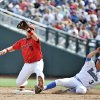 Photo -   UCLA's Kevin Kramer (3) beats the throw to second baseman Maxx Tissenbaum (8), on a fielder's choice by Kevin Williams, in the first inning of an NCAA College World Series baseball game in Omaha, Neb., Friday, June 15, 2012. (AP Photo/Eric Francis)