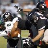 Norman North\'s Z\'Quan Hogan is tackled by a group of Yukon defenders during a high school football game between Yukon and Norman North in Yukon, Okla., Friday, Oct. 4, 2013. Photo by Sarah Phipps, The Oklahoman