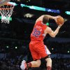 Los Angeles Clippers\' Blake Griffin twists as he dunks during the Slam Dunk Contest at the NBA basketball All-Star Saturday Night, Saturday, Feb. 19, 2011, in Los Angeles. (AP Photo/Mark J. Terrill)