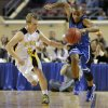 Coyle\'s Lashay Johnson tries to stay in bounds beside Arnett\'s Taylor Coburn during the Class B boys state championship game between Coyle and Arnett in the State Fair Arena at State Fair Park in Oklahoma City, Saturday, March 2, 2013. Photo by Bryan Terry, The Oklahoman