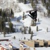 Photo - Two-time Olympic gold medalist Shaun White takes to the air off of a private jump built at Copper Mountain, Colo., Friday, Jan 24, 2014. After deciding to opt out of the Winter X Games in Aspen, Colo., earlier this week, White switched his focus to Sochi and had the large slopestyle feature with airbag landing built at Copper Mountain. (AP Photo/Summit Daily News, Sebastian Foltz)