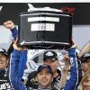 Photo - Jimmie Johnson holds up his trophy next to his wife Chandra, right, after winning the Daytona 500 NASCAR Sprint Cup Series auto race, Sunday, Feb. 24, 2013, at Daytona International Speedway in Daytona Beach, Fla. (AP Photo/Terry Renna)