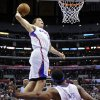 Los Angeles Clippers forward Blake Griffin, top, goes up for a dunk on an alley-oop by guard Baron Davis, below, during the first half of an NBA basketball game against the Denver Nuggets, Wednesday, Jan. 5, 2011, in Los Angeles. (AP Photo/Mark J. Terrill) ORG XMIT: LAS101