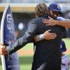Photo - San Diego Padres' Hall of Fame pitcher Trevor Hoffman, left, hugs Padres' Mark Kotsay, right, after he presented a custom surfboard to Kotsay before a baseball game against the Arizona Diamondbacks on Thursday, Sept. 26, 2013, in San Diego. (AP Photo/Don Boomer)