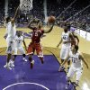 Oklahoma guard Je\'lon Hornbeak (5) drives to the basket against Kansas State defenders during the first half of an NCAA college basketball game Saturday, Jan. 19, 2013, in Manhattan, Kan. (AP Photo/Charlie Riedel)