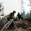Members to the Horseshoe Meadow Hotshots Chuck Ervin, left, and Ian White prepare a fire break at the Rim Fire in the Stanislaus National Forest Tuesday, Aug. 20, 2013. (AP Photo/The Modesto Bee, Andy Alfaro) LOCAL TV OUT (KXTV10, KCRA3, KOVR13, FOX40, KMAX31, KQCA58, CENTRAL VALLEY TV); LOCAL PRINT OUT (TURLOCK JOURNAL, CERES COURIER, OAKDALE LEADER, MODESTO VIEW, PATTERSON IRRIGATOR, MANTECA BULLETIN, RIPON, RECROD, SONORA UNION DEMOCRAT, AMADOR LEDGER DISPATCH, ESCALON TIMES, CALAVERAS ENTERPRISE, RIVERBANKS NEWS) LOCAL INTERNET OUT (TURLOCK CITY NEWS.COM, MOTHER LODE.COM)