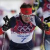 Photo - Russia's Maxim Vylegzhanin competes during the men's cross-country 30k skiathlon at the 2014 Winter Olympics, Sunday, Feb. 9, 2014, in Krasnaya Polyana, Russia. (AP Photo/Matthias Schrader)