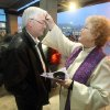 Rev. Kathleen Kingslight of St. Paul\'s Episcopal Church of Bremerton, Wash. offers the application of ashes to commuter David Carnahan at the Bremerton Transportation Center on Wednesday, Feb. 22, 2012. (AP Photo/Kitsap Sun, Larry Steagall)