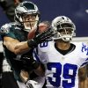 Photo - Philadelphia Eagles wide receiver Riley Cooper (14) makes a touchdown reception as Dallas Cowboys cornerback Brandon Carr (39) defends during the second half of an NFL football game, Sunday, Dec. 2, 2012, in Arlington, Texas. (AP Photo/LM Otero)