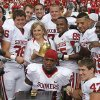 Oklahoma Gov. Mary Fallin holds the Golden Hat trophy as she poses for a photo with members of the Sooners after Oklahoma\'s 55-17 win over Texas during the Red River Rivalry college football game between the University of Oklahoma Sooners (OU) and the University of Texas Longhorns (UT) at the Cotton Bowl in Dallas, Saturday, Oct. 8, 2011. Photo by Chris Landsberger, The Oklahoman